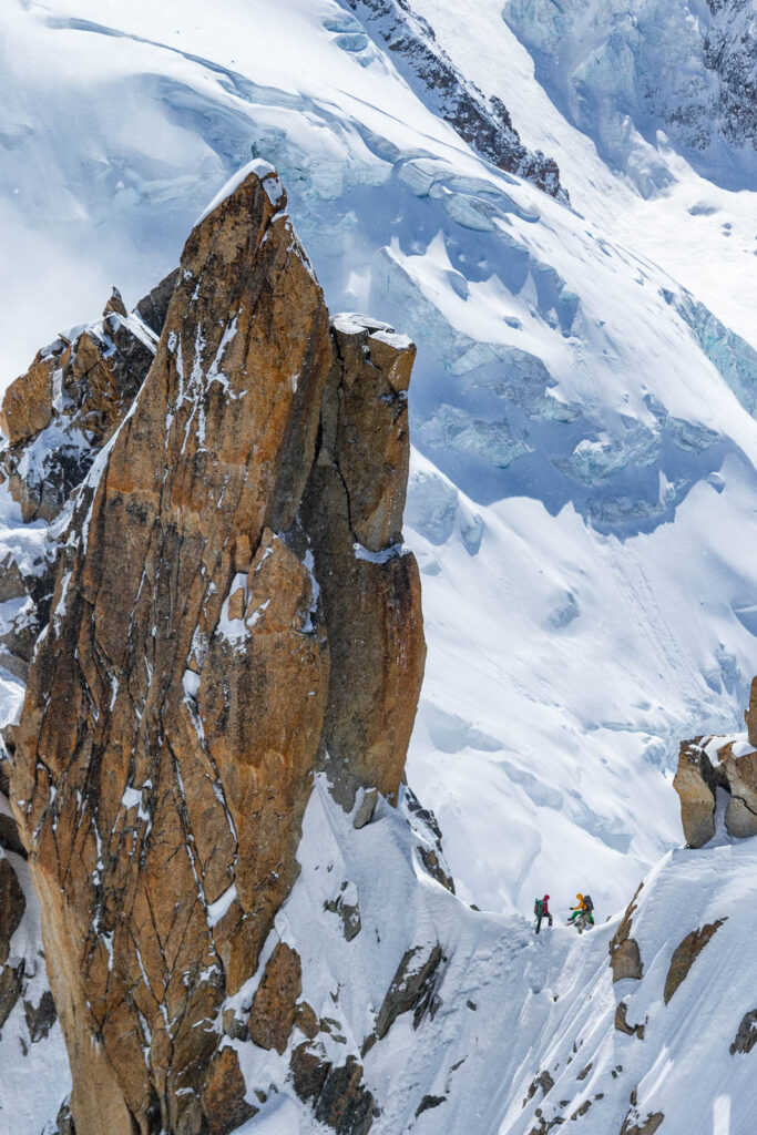 Climbers on the Cosmique Arete.